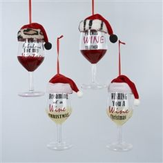 festive wine glass christmas ornaments are topped with santa hats some of the santa hats