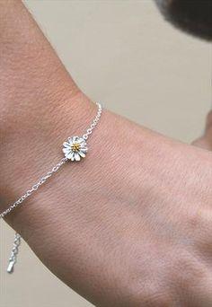 silver daisy charm bracelet from Astrid  Miyu Jewellery