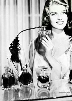 Glamour old Hollywood style Rita Hayworth looking gorgeous while spraying perfume Hollywood Icons, Old Hollywood Glamour, Golden Age Of Hollywood, Vintage Hollywood, Hollywood Stars, Hollywood Actresses, Glamour Hollywoodien, Vintage Glamour, Vintage Beauty