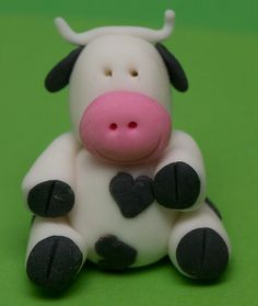 Dairy cow cupcake topper. by CupcakesByTara, via Flickr