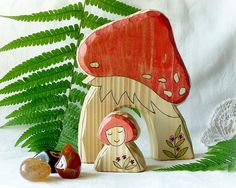 Fly Agaric Toadstool Mushroom House and little Gnome -- wooden toy.    on a farm grouped house in Menik, small Moravian village (Czech Republic, European Union).