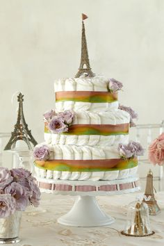 """Parisian-Themed Diaper Cake. Upon receiving this three-tiered diaper cake with 100 HUGGIES® Pure & Natural Diapers, mom will express her thanks in the only way fitting. With a """"merci."""""""