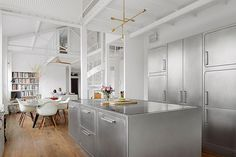 This Parisian Apartment Has a Stunning All-Stainless Steel Kitchen (1)