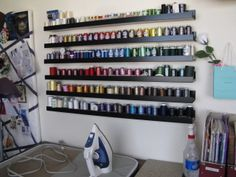 IKEA Sewing Room Ideas | She used the same idea by cutting the shelf down into sections to hold ...