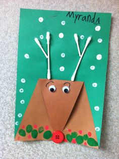 Simple reindeer craft made with one triangular piece of paper folded down for the nose and QTip antlers.