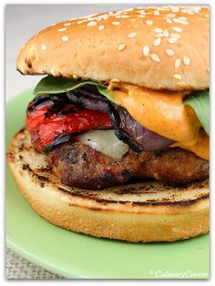 Grilled Turkey Burgers w/ cheese , grilled peppers, fresh baby spinach & Smoky Aioli .... yum.