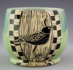 Handmade pottery tumbler with black and white etched design of quail. Sides and interior in celadon green color.  This would add character to the table!