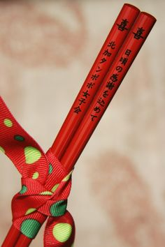 A beautiful red personalized chopstick engraved vertically with Japanese text. Personalized Wedding Favors, Unique Wedding Favors, Unique Weddings, Top Pic, Colour Board, Japanese Culture, Wedding Table, Special Occasion