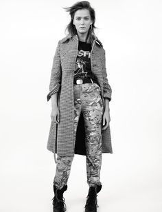 Carmen wears coat and pants Vetements. T-shirt, boots and belt stylist's studio. Earrings Balenciaga.  Carmen Kass, 37, modeling for 23 years Photography Amy Troost