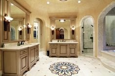 Great bathroom with Venetian inspired plaster walls and inlaid floor medallion