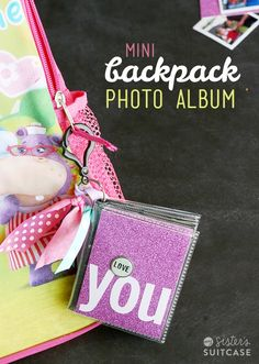 Make a MIni Photo Album for the kids backpacks to remind them of home! Easy $2 project from sisterssuitcaseblog.com