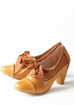 Madison Oxford Pumps By Chelsea Crew 64.99 at shopruche.com. Take the stage in these finely crafted oxford pumps. These leatherette and faux suede mustard heels feature a lace-up grosgrain closure, scalloped detailing, and charming brown piping.