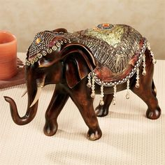 When nature's majesty combines with lavish finery, the Bejeweled Elephant Sculpture approaches a royal appearance. This resin table sculpture depicts a proud. Asian Elephant, Elephant Love, Elephant Art, Elephant Stuff, Elephant Gifts, Elephant Table, Elephant Home Decor, Elephant Decorations, Animal Statues