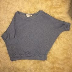 Knitted top Mid sleeve, says large but fits small and medium just right. The color is like a blue gray Mine Tops Blouses