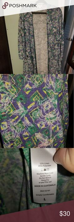 Lularoe large Sarah Awesome rose print Sarah. Green and purple with  some yellows and pinks and a white rose print.  Beautiful!! Worn once.  Smoke free home 🐱cat friendly home. LuLaRoe Sweaters Cardigans