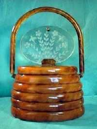 The BEEHIVE bag! It's the Holy Grail of Lucite handbags. Honeybees and flowers carved on lid.