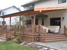 Here's a shed style sloped deck patio roof.