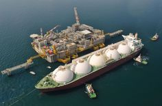 Adriatic LNG terminal a liquid gas tanker unloads on the floating concrete terminal