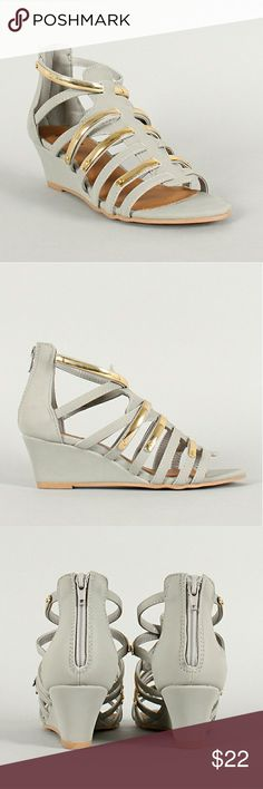 Qupid Strappy Open Toe Wedge Sandals 6.5 New. Never worn. Metallic gold accents. Cushioned insole.  Size 6.5 but might be better for someone who normally wears size 7. The color appears darker in the photos I uploaded. Qupid Shoes Sandals