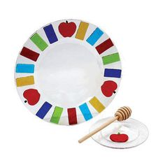 $90 - Colorful apple and honey set handmade by artist Tamara Baskin. Fused glass, multicolor sunburst border, with 3 apples on rim, 5'' honey dish, comes with wooden honey dipper.