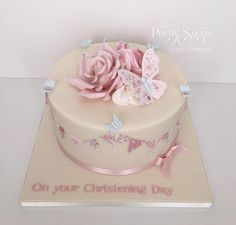 Christening cake inspired by floral bunting invitations. Sugar rose and butterflies detail