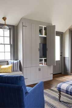 For a high-end look without the cost, we started with Ikea cabinetry, then turned to Semihandmade a company that makes stylish custom doors for Ikea cabinets, to create a wood-paneled wall of storage (one built-in for media and one for coats).