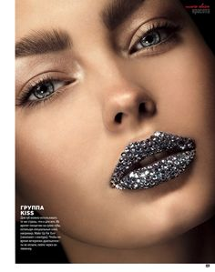 Glitter glam lips with diamantes giving silver shine, skin neutral tone, big bushy eyebrows, beige eyeshadow. Photo by Norbert Kniat, for Marie Claire Ukraine.