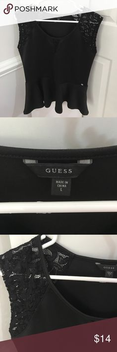 Guess Black Peplum Brand new and never worn. Super cute black peplum blouse. Has lace design. Stretchy material! Guess Tops Blouses