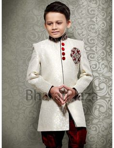 Ravishing off white color jacquard fabric indo western sherwani paired with maroon color breeches. Kids Party Wear Dresses, Prom Dresses, Kids Kurta, Kids Ethnic Wear, Little Boy Outfits, Kids Fashion Boy, Off White Color, Jacquard Fabric, Maroon Color