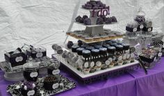 The Dessert & Candy Table with black, white and purple candy from Nuts.com The 5 Tier white PVC cupcake/cakepop stand from thesmartbaker.com is so versatile and easy to clean & put together and can be decorated for any occasion! Smokin hot deal on sale for $64.95 right now! Add the cake pop rings if you want even more uses. I added the suckers on the bottom only for this occasion.