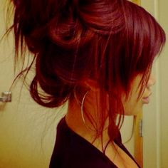 Messy red bun. Love the hoops.