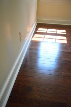 Young House Love - follow up post about how to deal with tricky installation issues (for doing your own wood floors) like transitions, angled walls, door jambs, how the wood meets the top of the stairs, etc.
