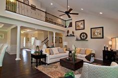 Living room with high ceilings and beautiful dark wood floors.