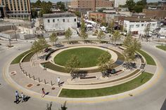 A ring of trees in the Circle will mature into a pleasant grove in the center of the intersection. Visitors may walk on two pathways or the central lawn, or relax on benches constructed of sustainably-harvested ipe wood.
