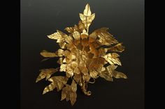 Ornament in the shape of a peony blossom<br>  Buried 1625; Tianqi period (1621-1627)<br>  From the tomb of Mu Changzuo at Mount Jiangjun, Nanjing; gold with filigree designs<br>  1 1/2 x 8 x 1 1/2 inches