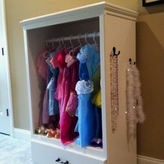 Dress up storage:  my awesome dad made this for Addie for Christmas!  It just needs a mirror on the other side and it will be complete.  Inspired by:  http://herhobby.blogspot.com/2009/09/dress-ups-closet.html