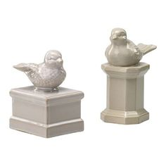 Original Caption- Cyan Design Ceramic Bird on Column Figurine in Gloss White Glaze  Mine- :D Perrty!   Haha I'm so horrible.