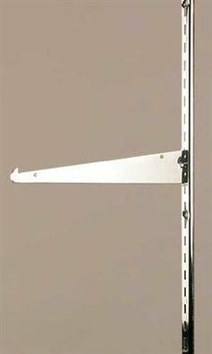 """Chrome Metal Shelf Brackets Fit 1/2"""" Slot Standards- 14"""" by Store Supply Warehouse. $1.09. Use 14''L Metal Shelf Brackets for slotted standards with 1/2"""" slots and 1""""O.C. Brackets have a chrome finish and are durable store fixtures."""