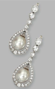 PAIR OF PLATINUM, NATURAL PEARL AND DIAMOND PENDANT-EARRINGS The pendants set with natural pearl drops measuring approximately 10.27 by 8.70 mm. and 10.23 by 8.94 mm., framed and surmounted by old European-cut, single-cut and rose-cut diamonds weighing approximately 3.00 carats.