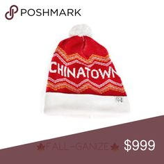 {tuck shop co.} Pom Pom Beanie Chinatown Unisex Multihued pom pom cap featuring rib knit Folded ribbed cuff Printed logo Acrylic Machine wash Made in Canada tuck shop co. Accessories Hats