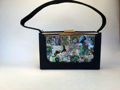 A personal favorite from my Etsy shop https://www.etsy.com/listing/294747417/elgin-american-vintage-abalone-purse