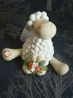 I made ten of these sheep for a wedding cake. The couple's surname is Shepherd hence the sheep theme.