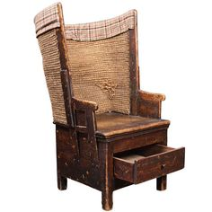 Scottish Primitive Tall Back Chair with Storage Drawer | From a unique collection of antique and modern armchairs at http://www.1stdibs.com/furniture/seating/armchairs/