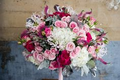 Pink and white bouquet of roses, hydrangea, veronica, dusty miller, berzillia berries, nerine