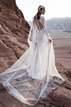 An off white silk chiffon long sleeve kaftan with embroidered transparent crystal beading and open back. Pnina Tornai 2016 Wedding Dress Collection