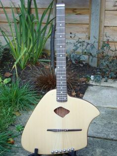 MaSH Ergo Acoustic Guitar  This axe uses steinberger tuners and headless neck to help it sit on proper playing position when you are seated.