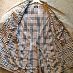 "BURBERRY NOVA CHECK BELTED TRENCH COAT JACKET BURBERRY sz 44 R, MENS (could also fit a woman's sz XXL)  Double breasted tan Trench Coat. EXCELLENT CONDITION, no tears or stains, Worn just a couple of times.. Classic tan exterior, double breasted with belt. Gorgeous NOVA CHECK interior, Epillettes on both shoulders and arms, shown.  Classic and pricey coat, Just gorgeous!  WILL SHIP RIGHT AWAY. Check out my other amazing items Measurements: top to bottom: 48"", Shoulder seam to end of arm is…"