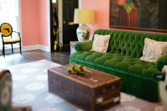 Peppermint Bliss - green tufted sofa - trunk as coffee table