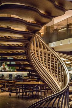 """Atmos Studio's spiralling timber staircase features """"leaf-like"""" stairs that emerge from a structural stem"""