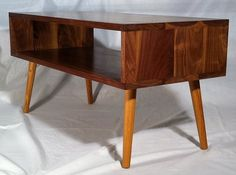 Mid Century/Modern coffee table. Practical storage and great design!